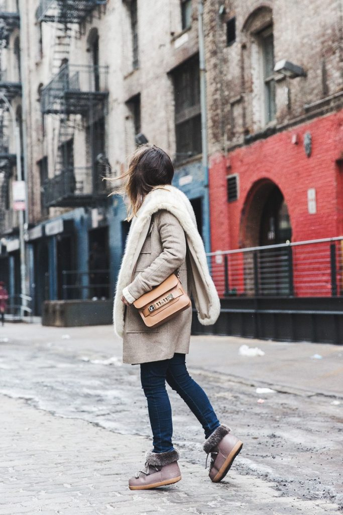 Street Style, February 2015: Sara Escudero is wearing a beige coat and scarf from Asos, jeans from TopShop, boots from IKKII, bag from Proenza Schouler