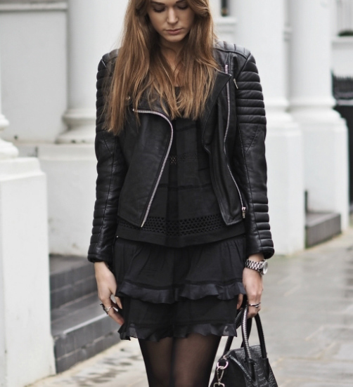 Tina Maria is wearing all black, leather jacket from Meotine and the top and skirt from Isabel Marant