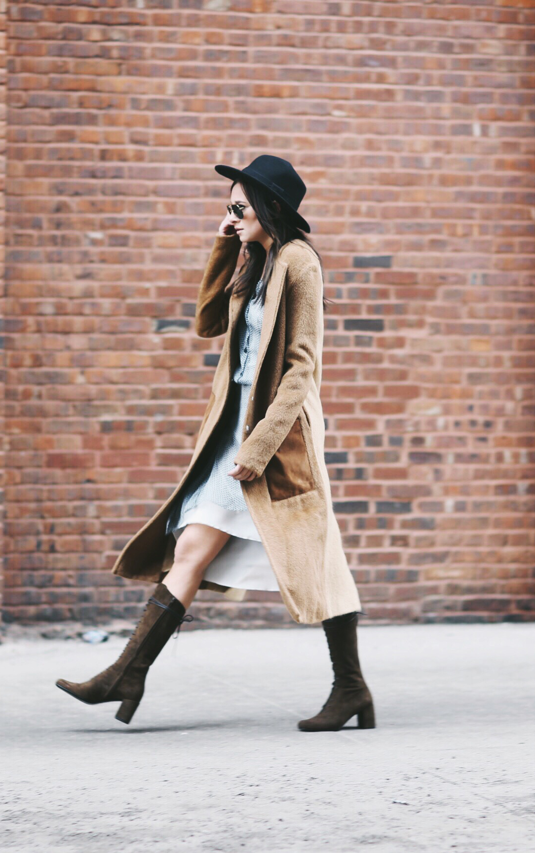 Street Style February 2015: Danielle Bernstein is wearing a white dress from Mulberry, camel coat from Edun and the boots are from Saint Laurent