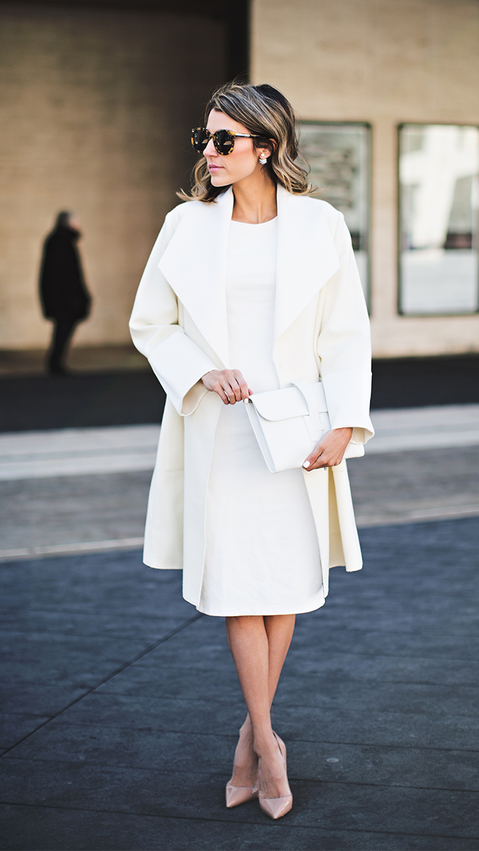 Christine Andrew is wearing a Adam Lippes overcoat with a Lulus midi dress and nude heels