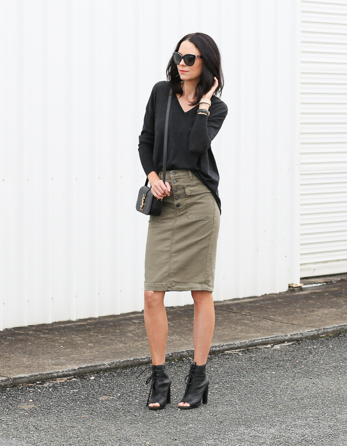 Fiona Edwards is in an edgy army green denim skirt and black lace up heels to complete a militarily inspired outfit Skirt: J Brand, Shoes: Manning Cartel