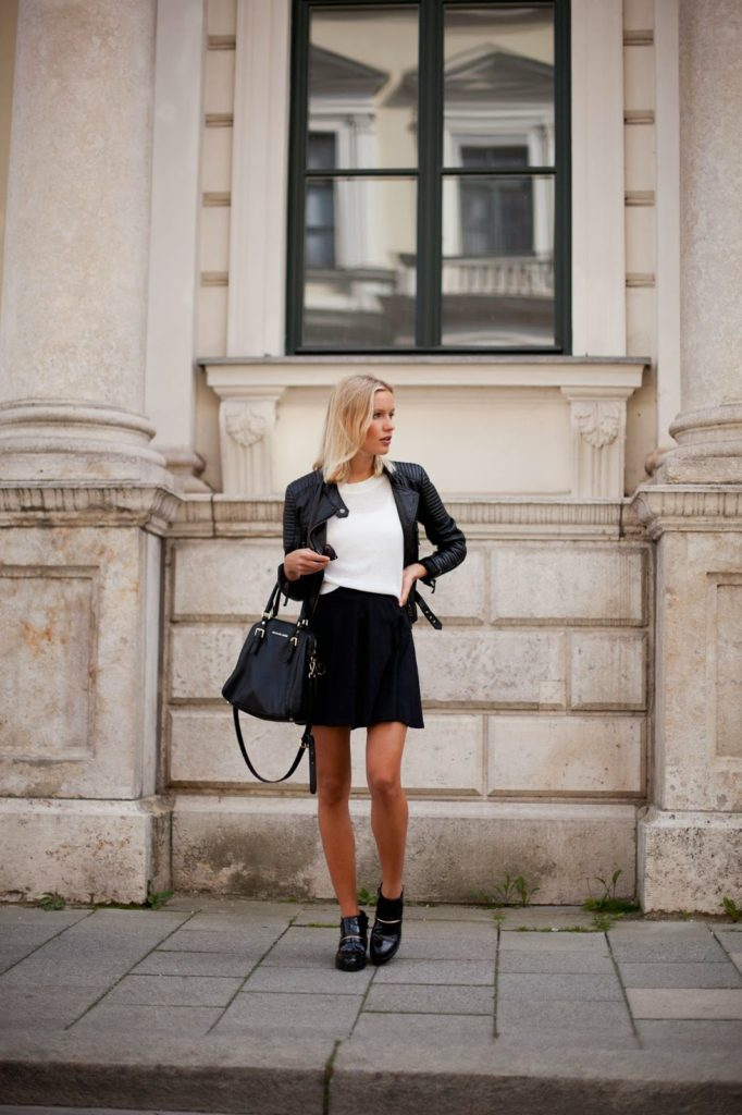 Jolie Janine in an all black and white outfit, leather biker jacket, skater skirt, white tee, ankle boots and a black handbag  Jacket: Zara, Skirt: New Look, Top: River Island, Bag: Michael Kors, Shoes: Zara