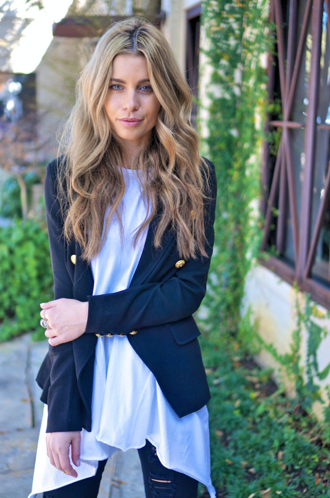 The pearl oyster is wearing a navy missguided blazer and a Nicole Kwon tank top