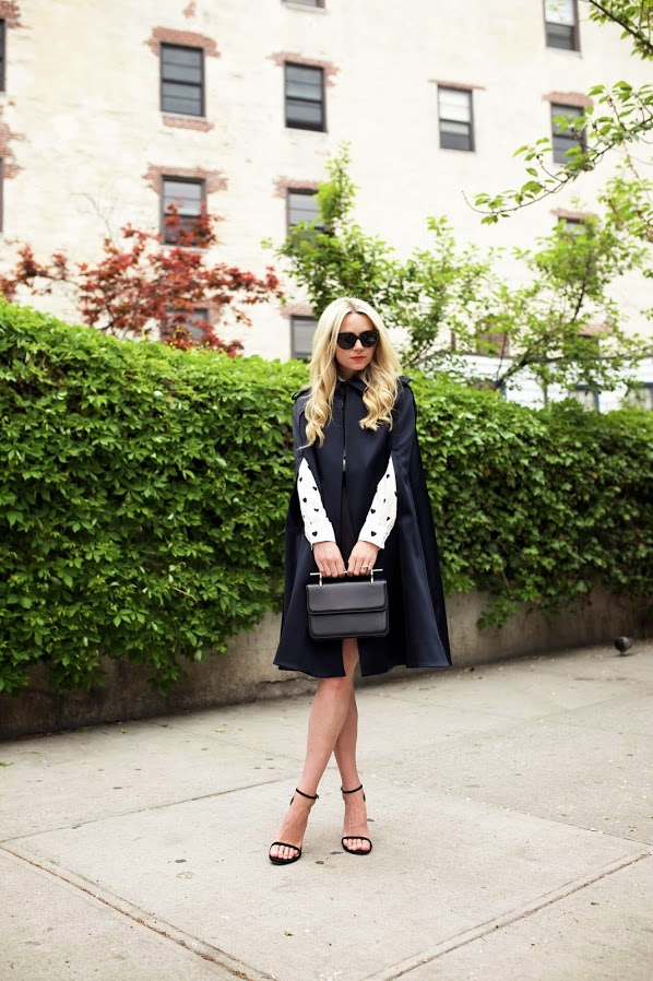 Black And White Outfit Ideas: Blair Eadie is wearing a black AYR cape with Joe Fresh shirt and a pair of Stuart Weitzman heels
