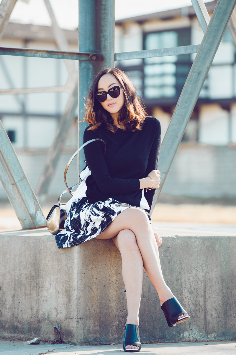 Black And White Casual Outfits: Chriselle Lim is wearing a black and white long sleeved top and printed skirt from Trouve with a pair of French Connection heels
