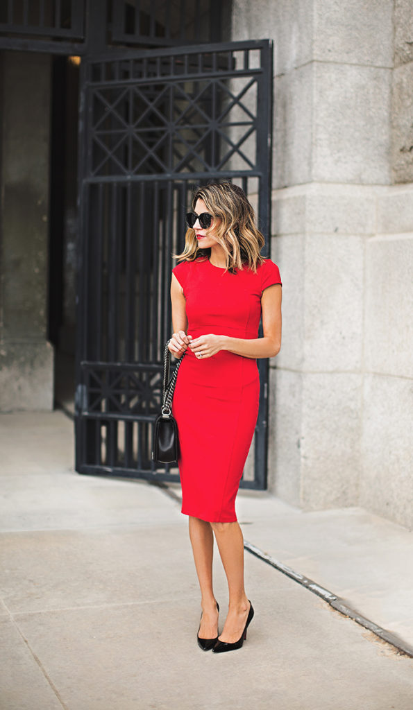 Christine Andrew is wearing a Felicity & Coco red pencil dress with a black Chanel bag and Christian Louboutin heels.