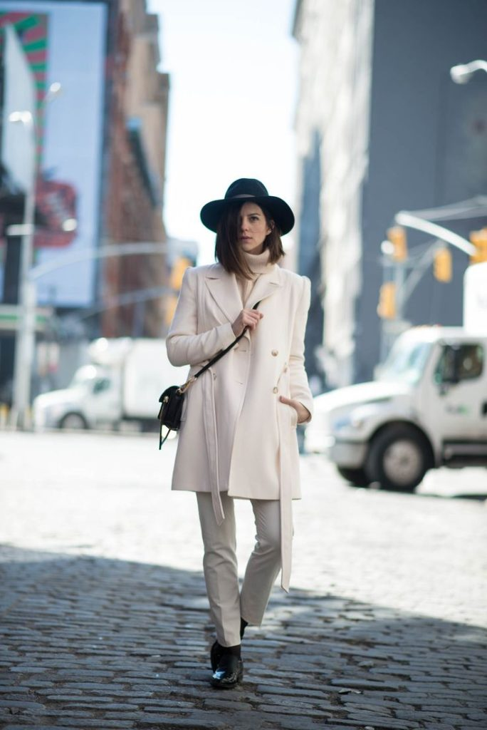 Street Style February 2015: Michelle is wearing a creme Reiss coat and pants with a Otte Ny hat