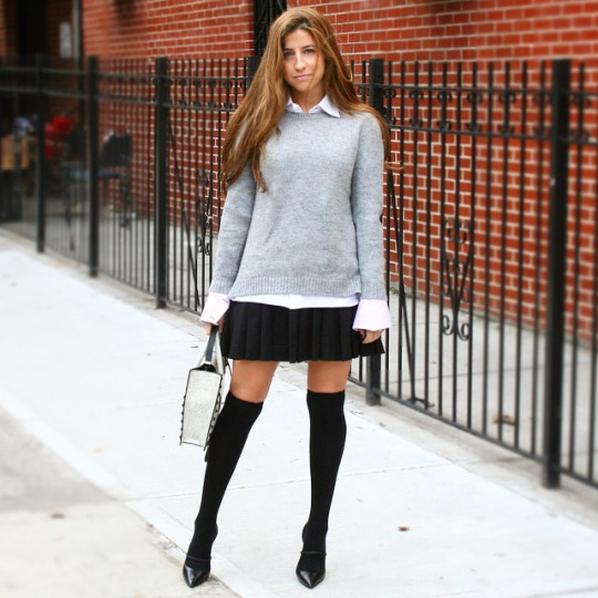 Instagram Fashion February 2015: @greyavenue_ is wearing a pale grey sweater with a black pleated mini skirt, knee high socks and heels