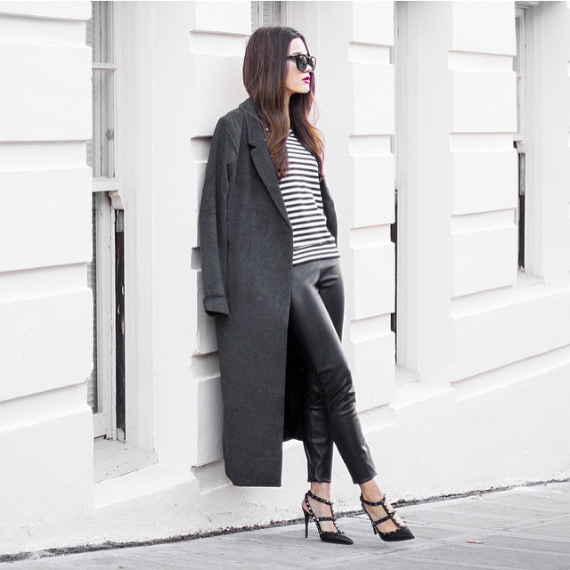 @sarahstylesseattle is wearing an ash grey maxi coat with a striped long sleeved t shirt, leather pants and black heels