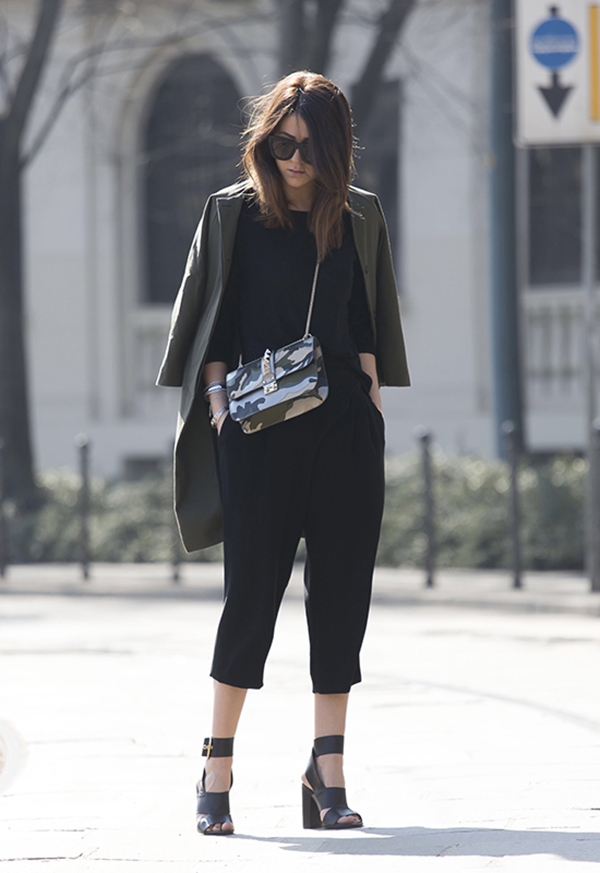 Military Inspired Outfit: Nicoletta Reggio is wearing a khaki jacket with an army print Valentino bag