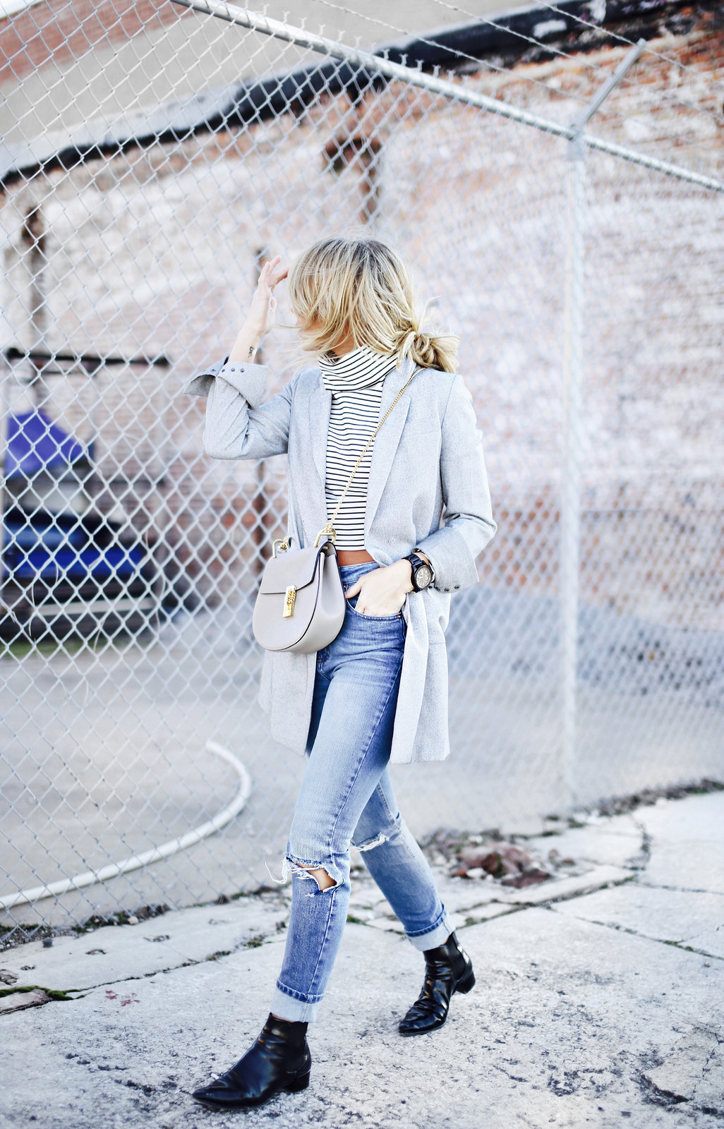 Striped Outfits And Ideas: Mary is wearing a white Finders Keepers pinstripe turtleneck with a pair of Topshop skinny jeans