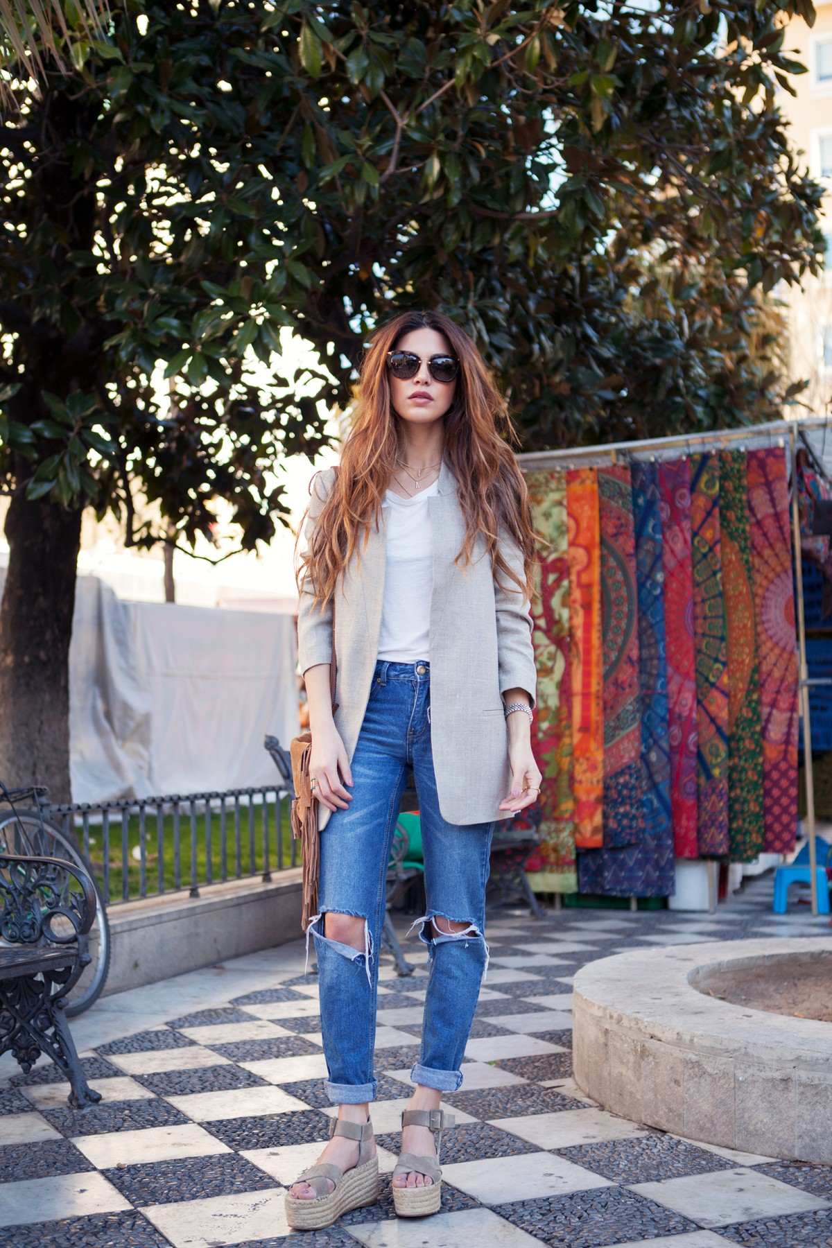 Negin Mirsalehi is wearing a pair of pale grey Céline Espadrilles Criss Cross platform sandals
