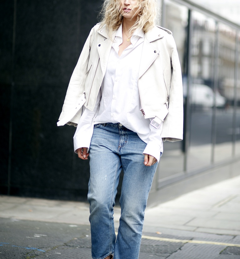 Anouk Yve is wearing a white Ganni leather jacket with Acne denim jeans