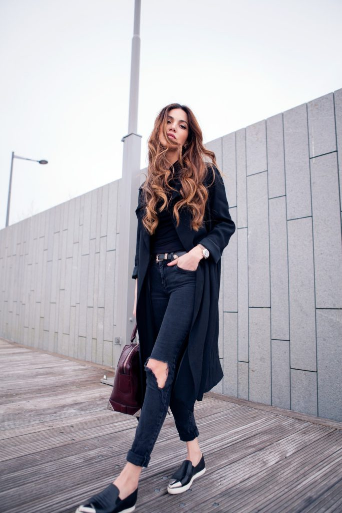 Via Just The Design: Negin Mirsalehi is wearing an oversized black coat with River Island skinny jeans with a pair of black Miu Miu pumps -back-in-black-8-1200