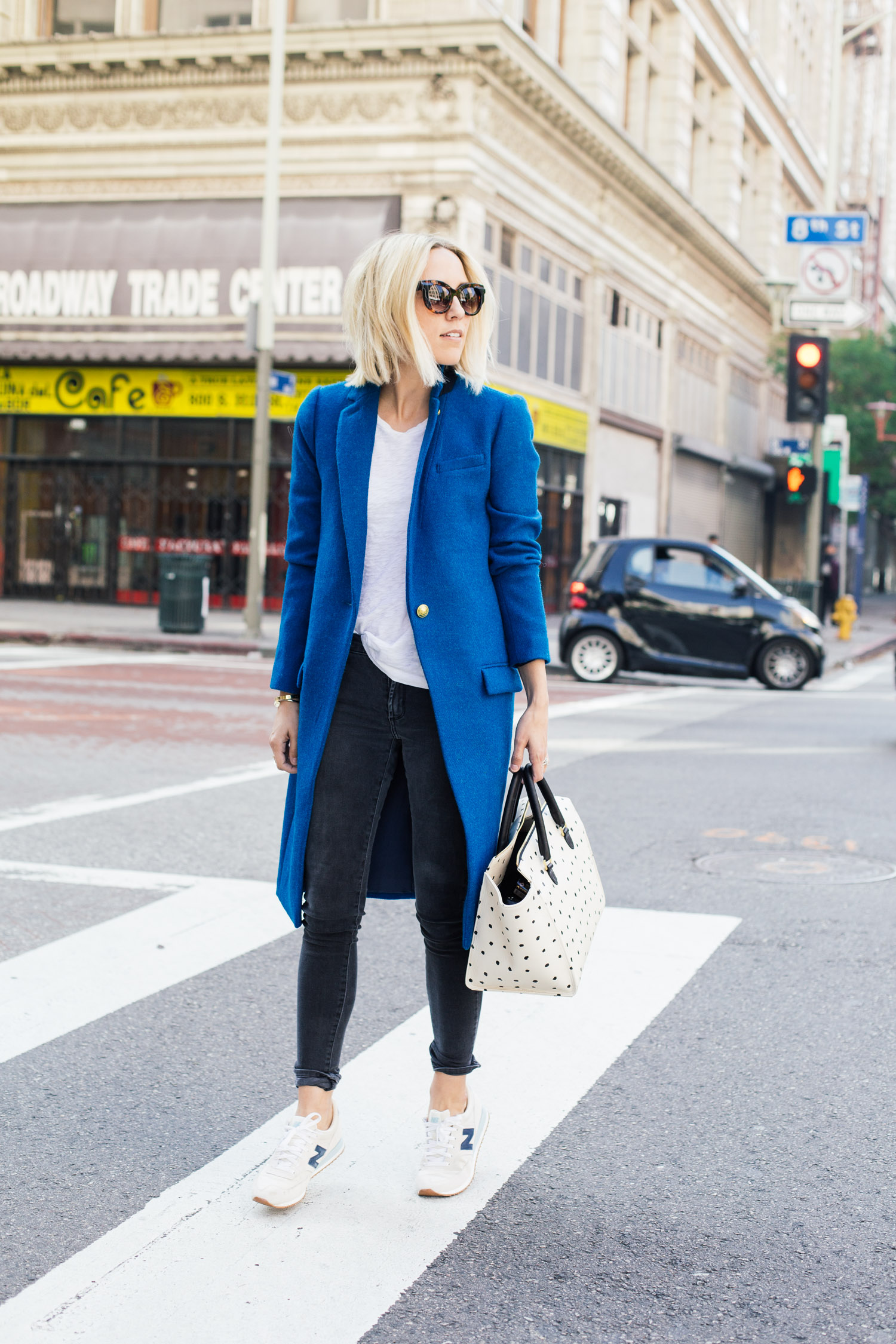 Jacey Duprie is wearing a blue coat from J. Crew and the black jeans are from James Jeans