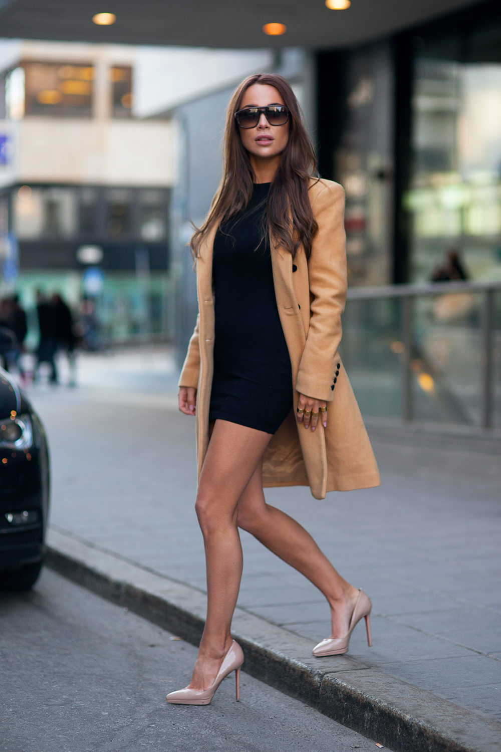 Johanna Olsson is wearing a nude shoes from Christian Loboutin, black dress from Asos Petit, camel coat from Selected Femme and the sunglasses are from Yves Saint Laurent