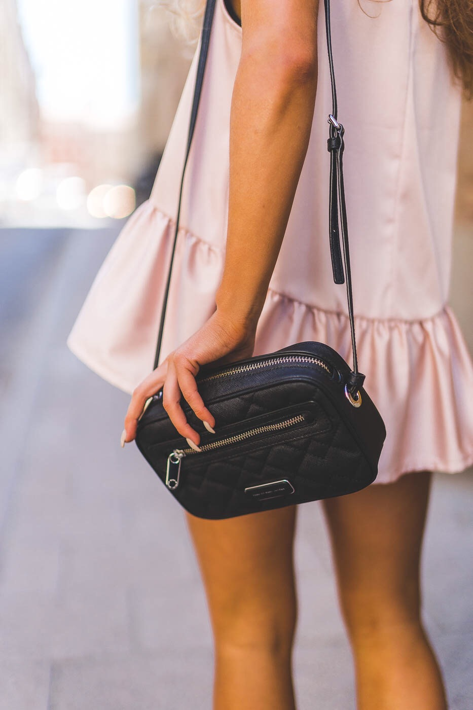 This outfit detail illustrates the blush pink trend well. Via Molly Rustas
