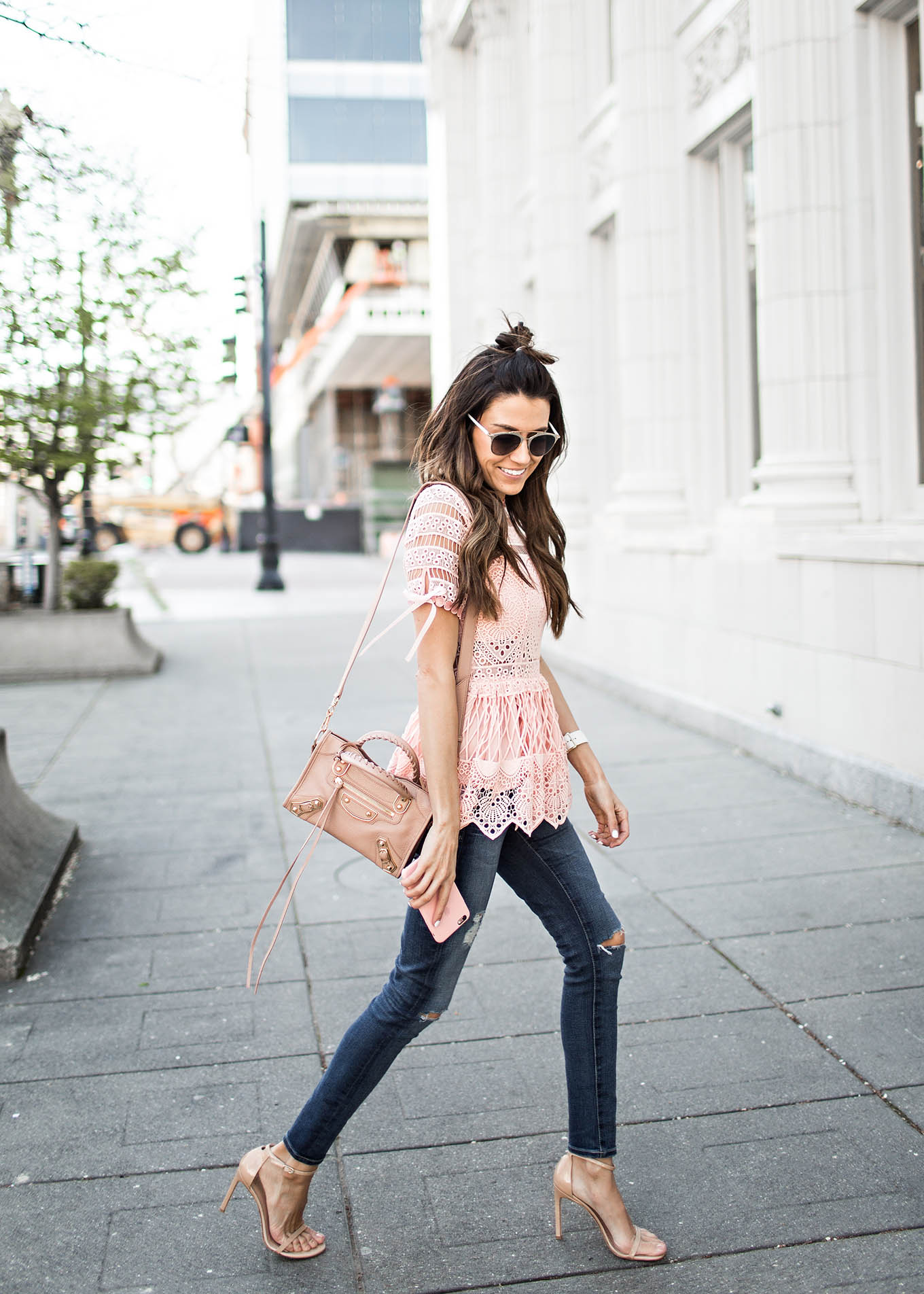 There is nothing prettier than blush pink lace! Christine Andrew looks utterly gorgeous in this ultra feminine style, worn on an intricate lace top. Pair something similar with heels and skinny jeans to steal Christine's style. Top: Intermix, Jeans: Saks Fifth Avenue.