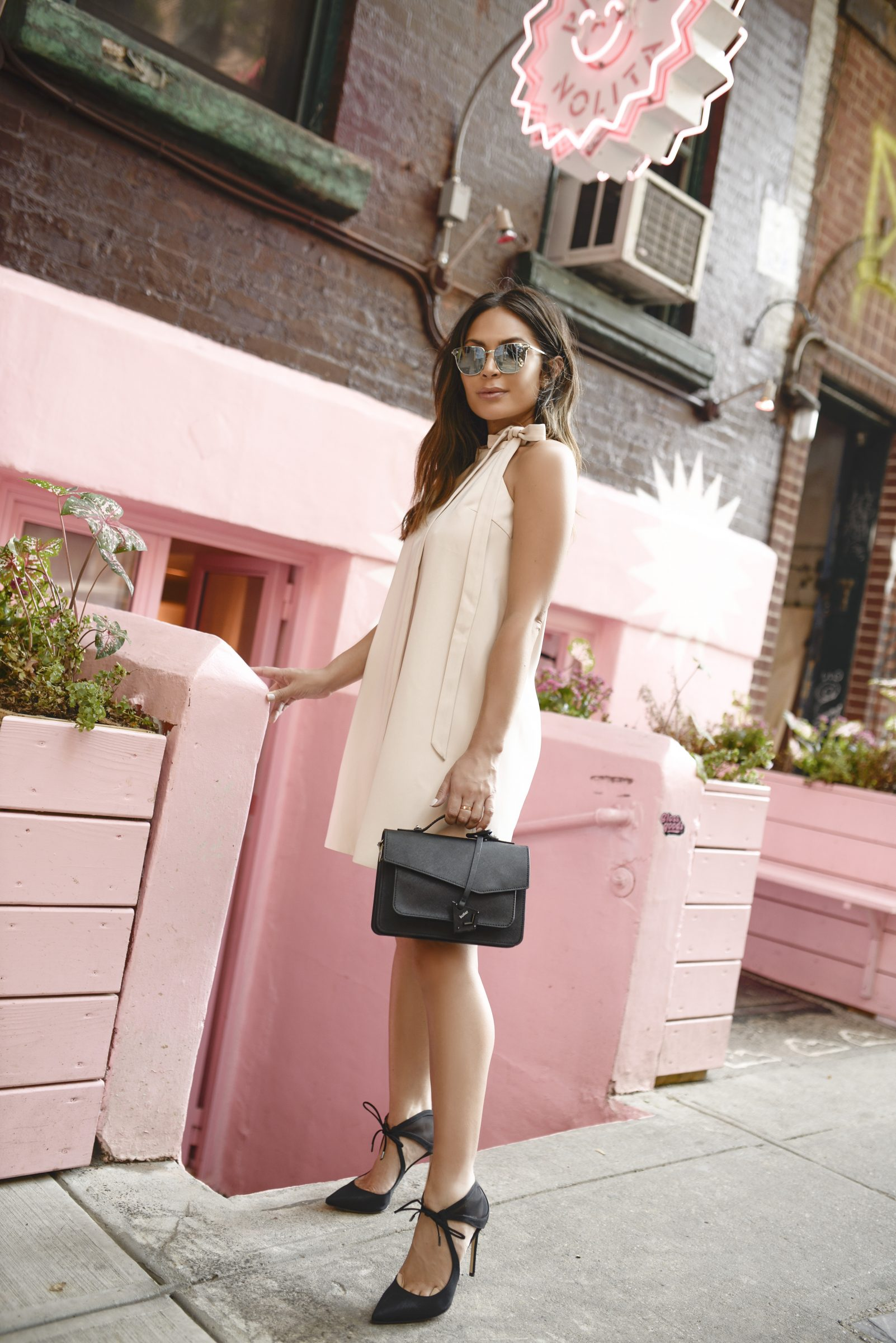 Why not try a blush pink smock dress like Marianna Hewitt to achieve an effortlessly feminine style this summer? Paired with stilettos and a clutch this outfit is perfect for evening and daytime wear!   Bag: Botkier Cobbie Hill.