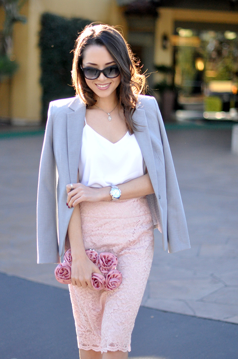 Jessica R. is wearing a blush lace pencil skirt from Express