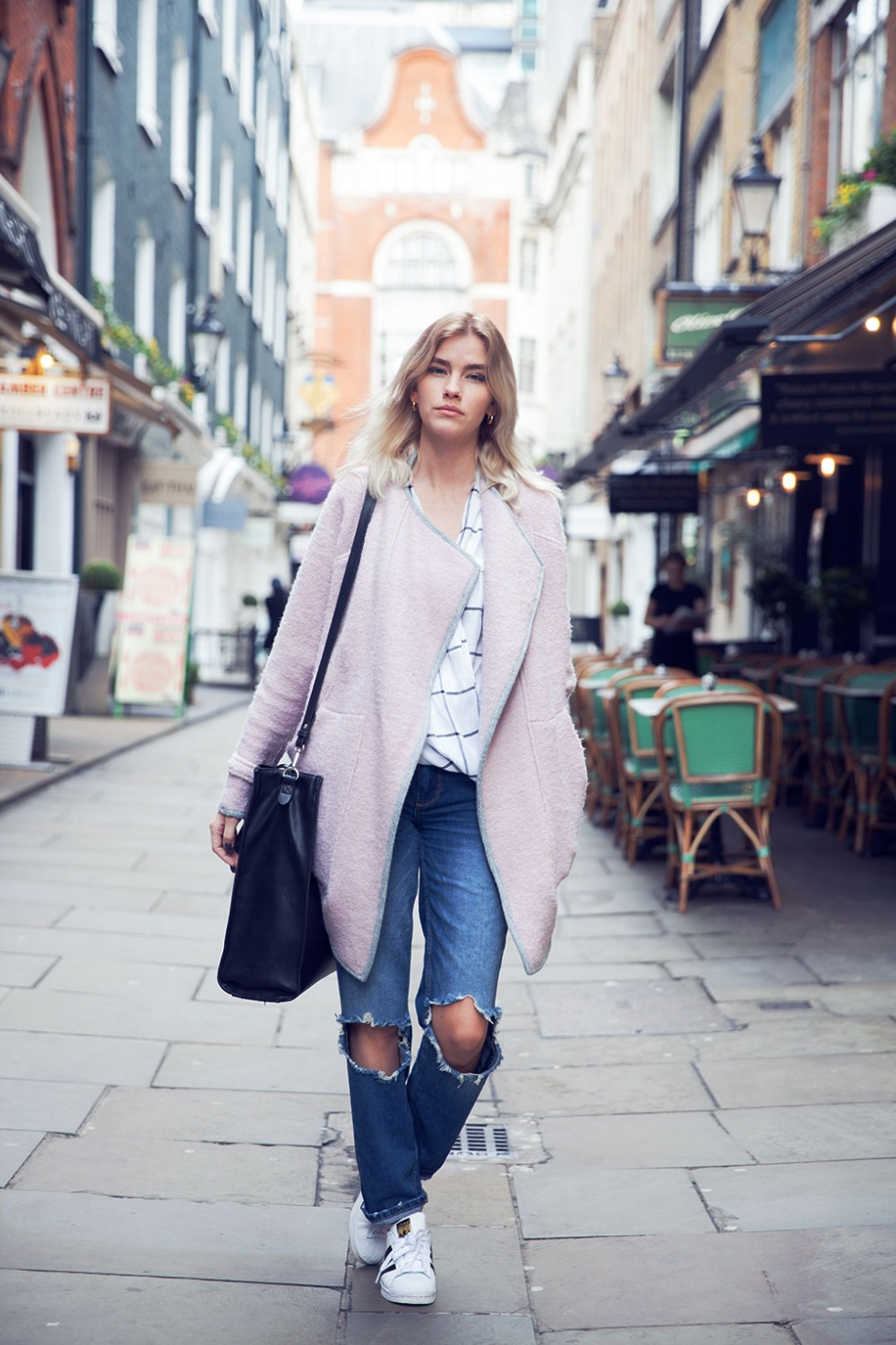 Elsa Ekman is wearing a rosy coat from River Island