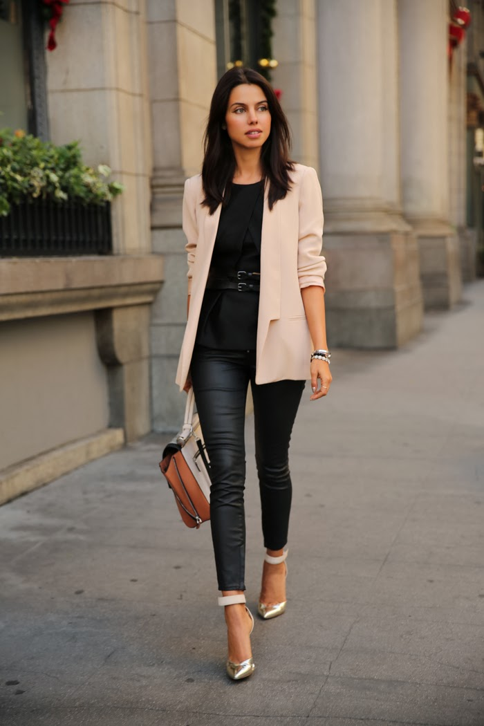 Annabelle Fleur is wearing a blush pink blazer from Truth & Pride