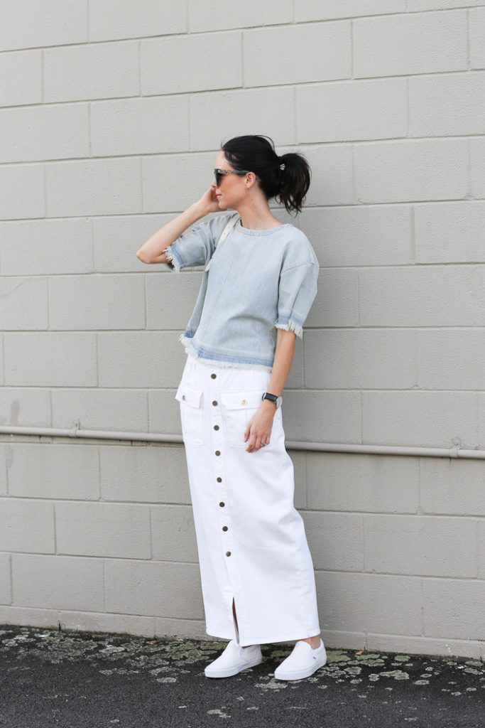 Long white button front skirt and a light blue frayed top. it doesn't come much more on point than than that. Via Fiona Edwards  Top: J Brand, Skirt: Frame Denim, Shoes: Vans, Bag: Proenza Schouler, Sunglasses: Wildfox Couture
