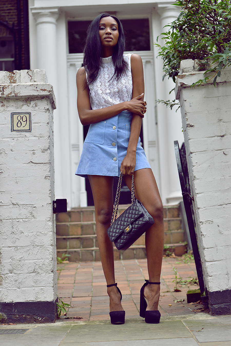 Pair a pastel button-front skirt with violet heels for an edgier look. Via Natasha Ndlovu. Blouse / Skirt / Shoes: Asos.