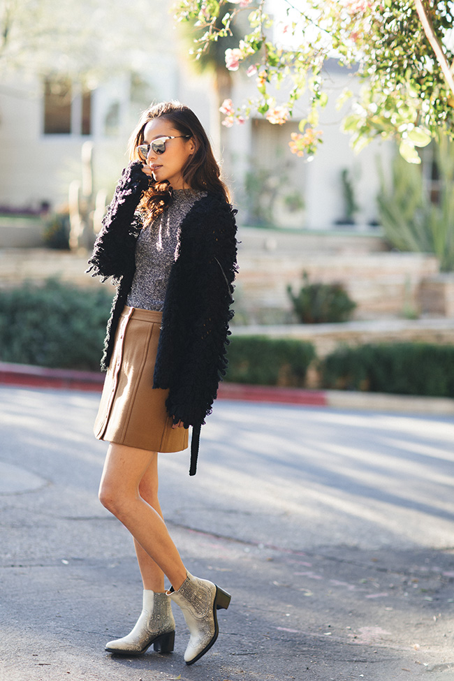 Wear a button front skirt like Jamie J Chung and pair it with snazzy faux snakeskin Chelsea boots and a fuzzy knit cardigan! This look is unique and original, we love it! Skirt: Madwell, Cardigan: Tularosa, Boots: The Office Of Angela Scott.