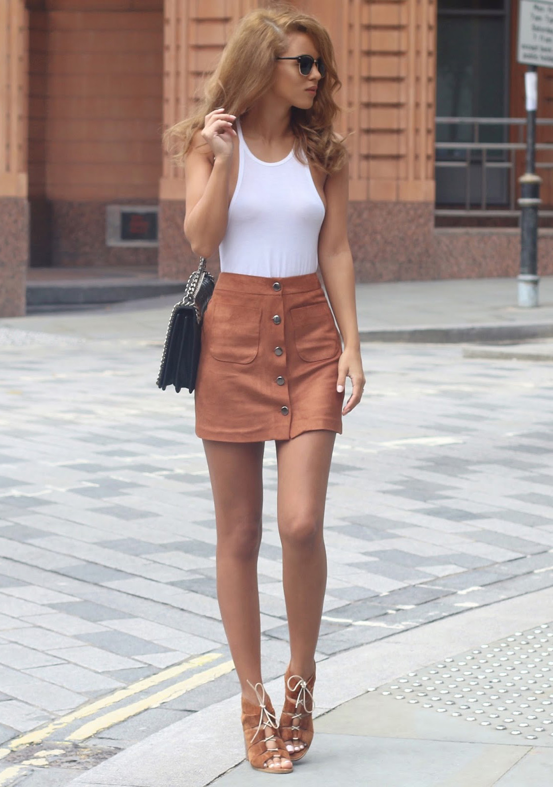 Wear your button front suede skirt with matching shoes and a white top. Via Nada Adelle Vine Tank: Kit And Ace, Suedette Mini Skirt: Miss Selfridge, Bag: Zara, Sunglasses: Asos, Shoes: Carvela
