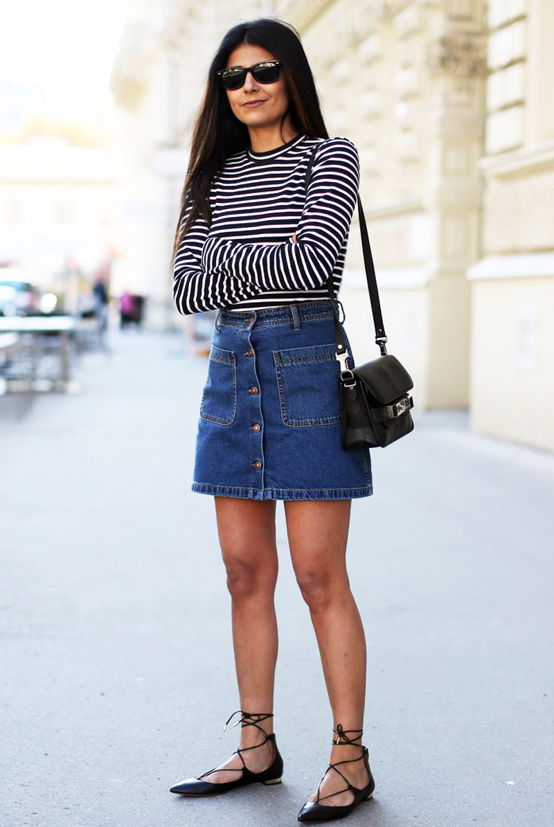 Laura Dittrich is wearing a button front denim skirt from Zara