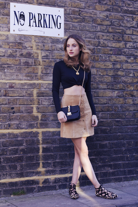 Rosie Fortescue is wearing a button fronted suede popper skirt from Miss Selfridge