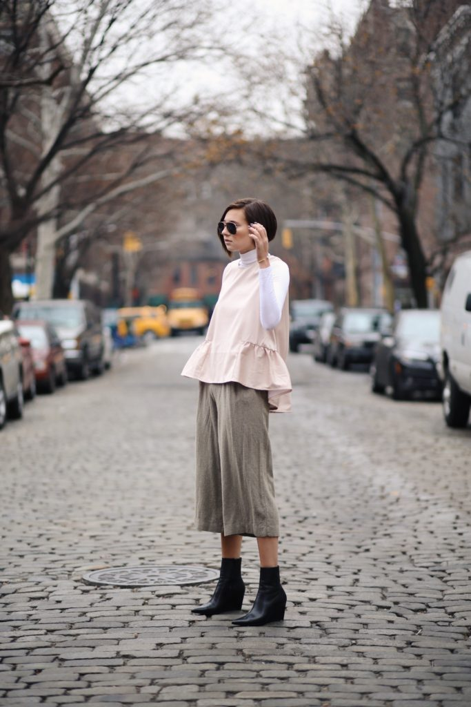 Danielle Bernstein is wearing a pale pink top from H&M
