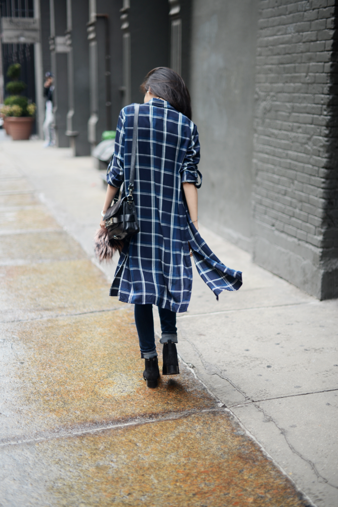 Long Over Long Fashion Trend: Van Le is wearing a navy blue plaid dress from Zara with Citizens Of Humanity denim skinny jeans