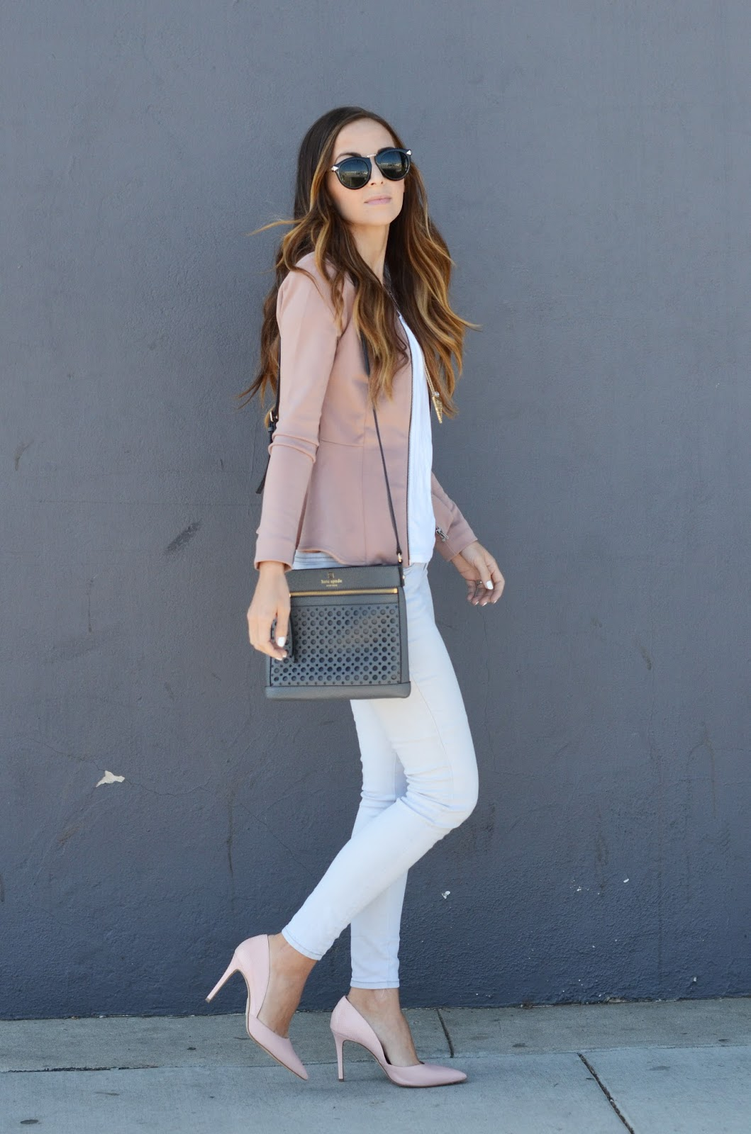 Via Just The Design: Merrick's Art is wearing a blush pink Topshop jacket with a pair of white Old Navy skinny jeans, pink heels and a black Kate Spade handbag