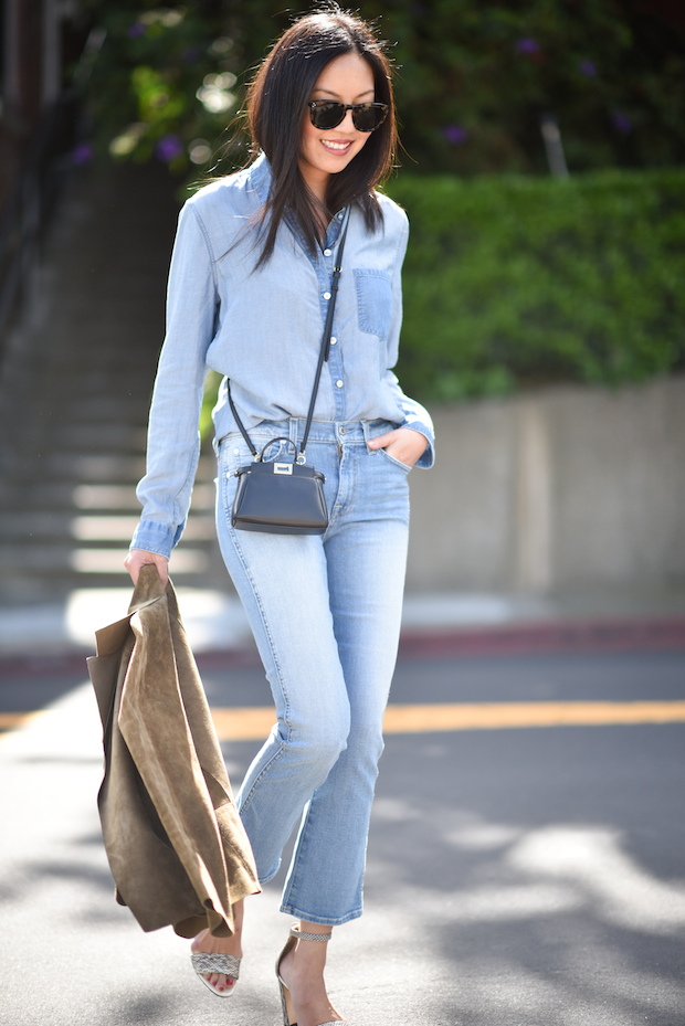 The denim on denim trend looks even more stylish worn in the same shade. We love Ann Taylor's choice to wear a pair of cropped flared jeans with a button up shirt. It is the perfect summer outfit! Denim: 7 For All Mankind.