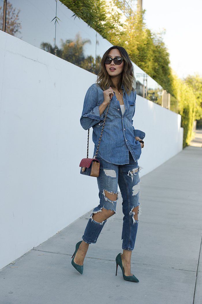 Aimee Song looks ultra cool in head to toe denim; combining destroyed jeans and a simplistic denim shirt from J. Crew. This look is super retro and perfect for every day wear. Denim Shirt: J.Crew, Jeans: Zara, Shoes: Christian Louboutin, Bag: Chanel.