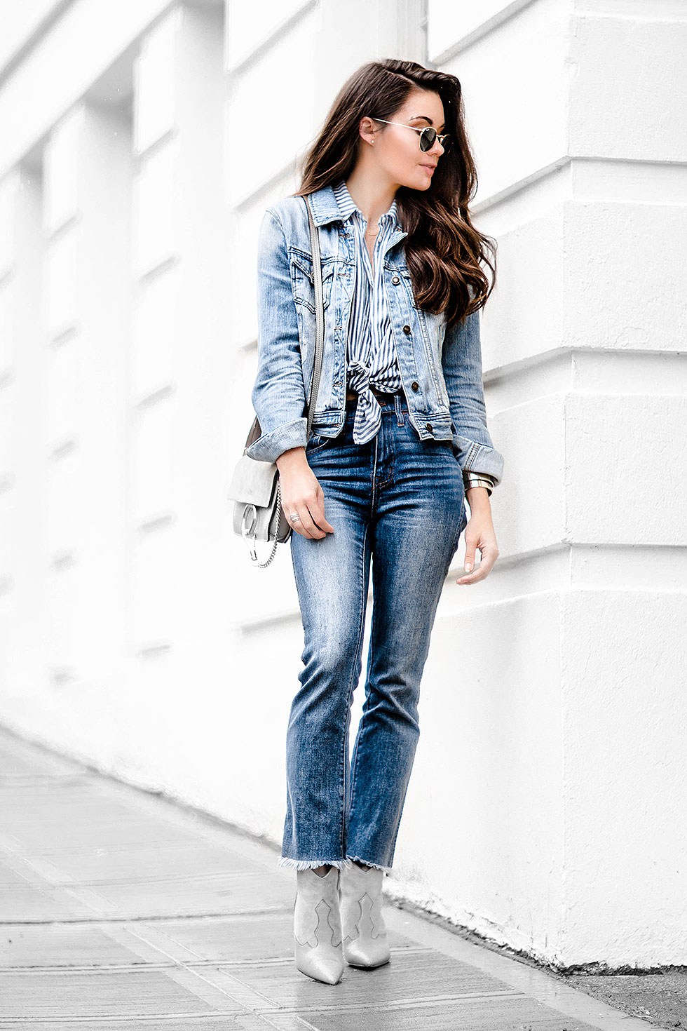 If you're looking for a classic retro style, wear the double denim trend with a waist tie striped shirt and cowboy boots like Sarah Butler! This look is effortlessly chic and infinitely trendy! Jeans/Shirt: Madewell, Jacket: Forever 21, Bag: Chloe.