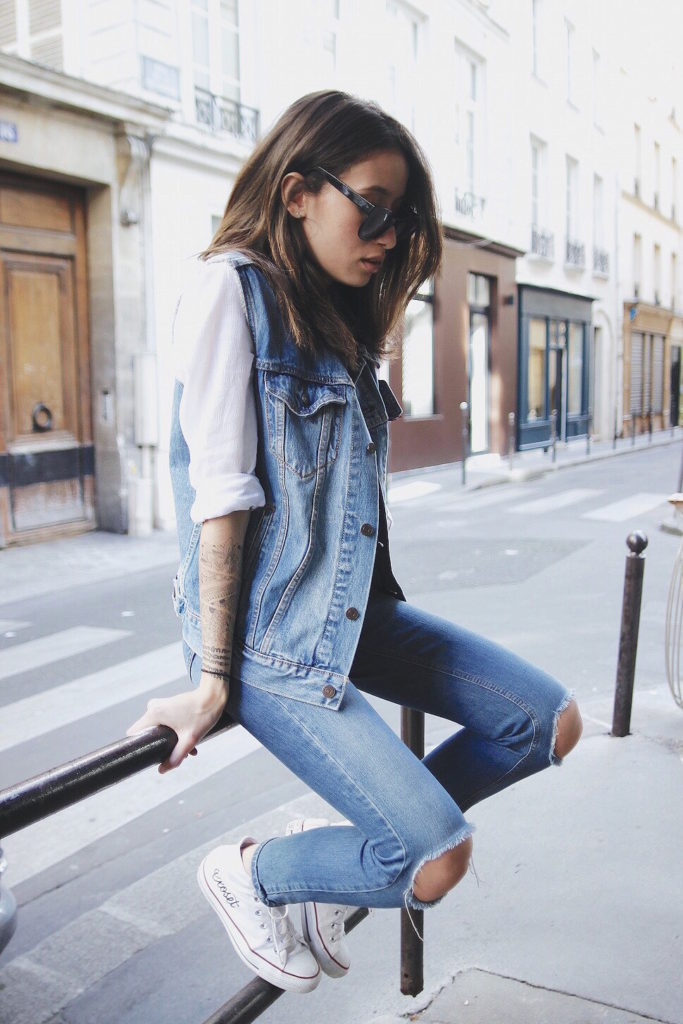 Alexandra Guerain is wearing a ripped denim jeans from Asos, denim vest from Levis Shirt, white shirt from Miss Guided and sneakers are from Converse
