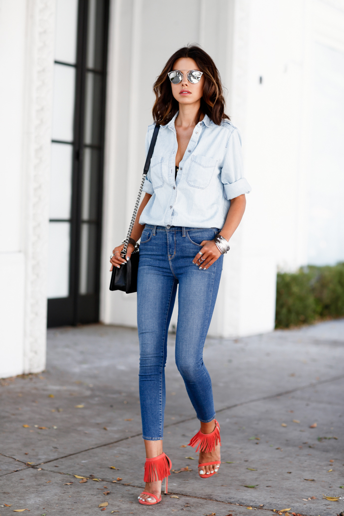 Shirt and high rise skinny jeans. The red sandals are added for a shock effect. Via: Annabelle Fleur Skinny Jeans: L'Agence Margot, Suede Sandals: Stuart Weitzman, Boyfriend Shirt: Express