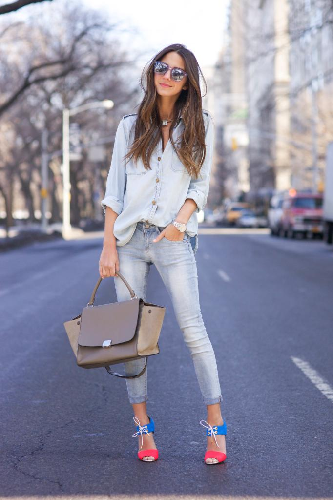 Denim on Denim: Arielle Nachami is wearing a light blue jeans from Hart Denim and the denim button down shirt is from Current Elliott