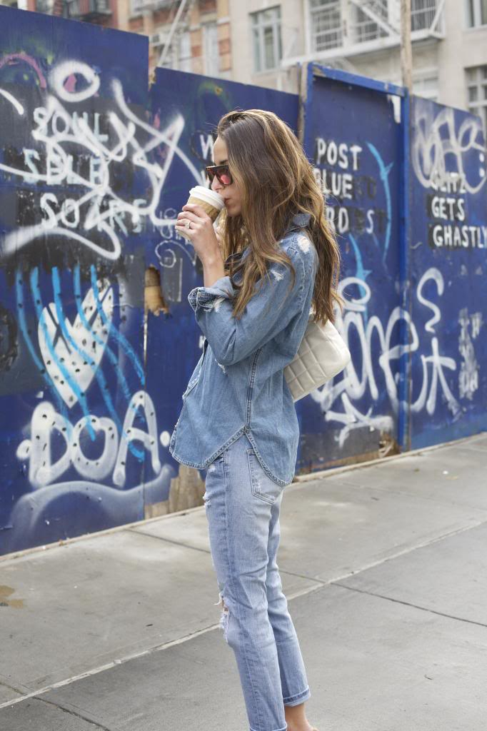 Denim On Denim: Arielle Nachami is wearing distressed denim shirt and jeans from Wildfox and Paige Denim respectively
