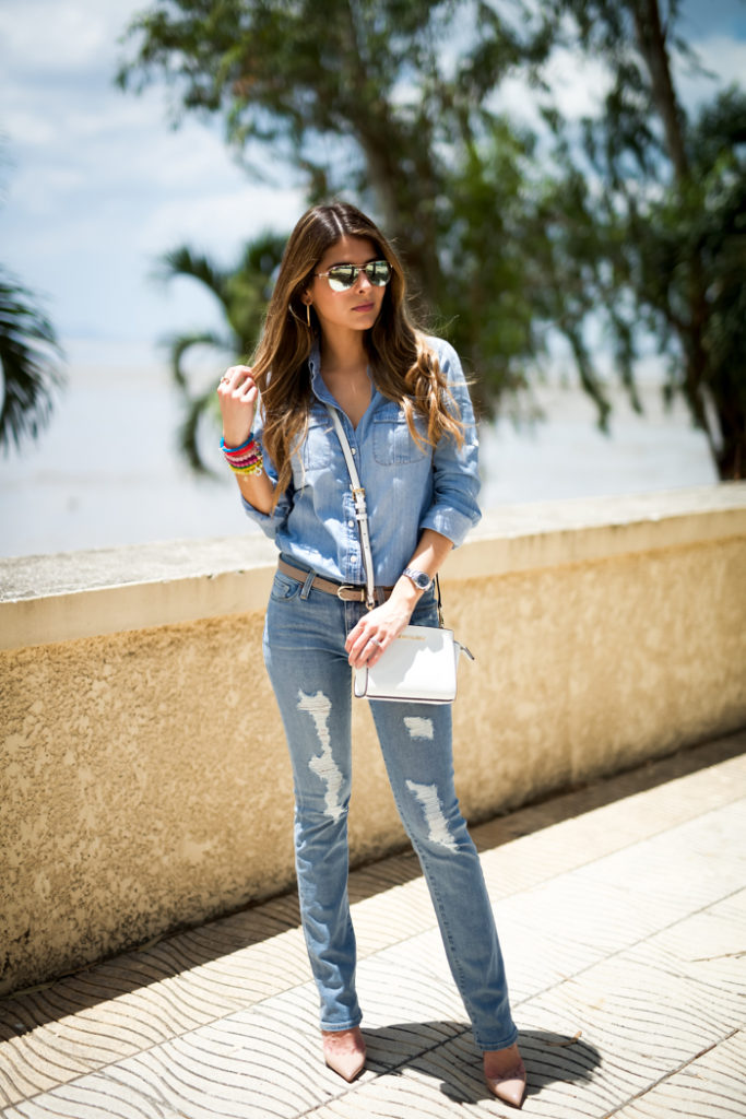Denim Outfits 2015: Pam Hetlinger is wearing a light wash denim J.Crew shirt with a pair of DSTLD distressed jeans