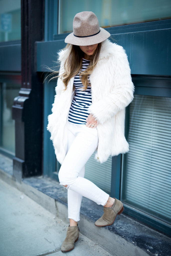 Just The Design: Pam Hetlinger is wearing a white Forever 21 faux fur jacket with a pair of ripped Free People skinny jeans and Sam Edelman ankle boots