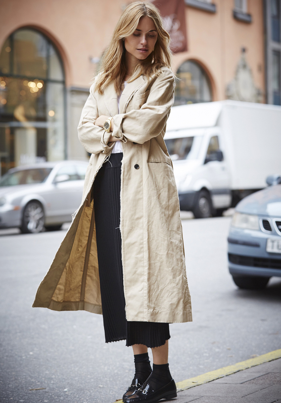 Street Style, March 2015: Pernille Teisbaek is wearing a trench coat with a pleated black maxi skirt all from House of Dagmar