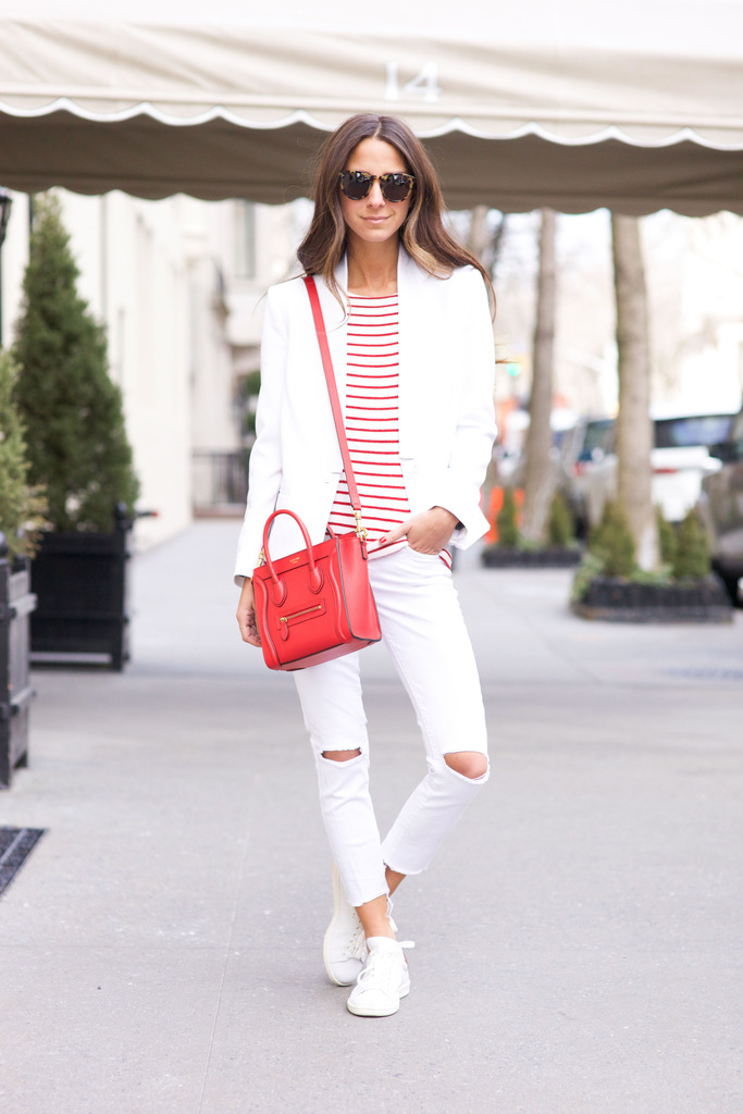How To Wear A Striped Top: Arielle Nachami is wearing a red and white Revolve Clothing striped top with a white J Brand blazer