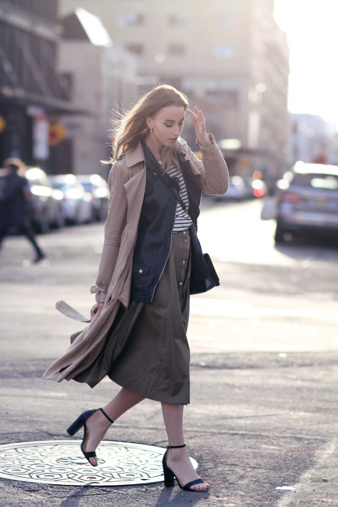 Long Button Downed Skirt: Noor De Groot is wearing a beige button downed maxi skirt