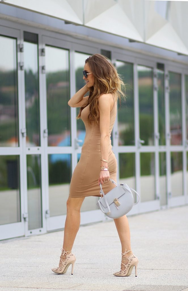 Accessorise A Neutral Dress: Ioana Chisiu is wearing a beige Missguided bodycon dress with a pair of nude Choies heels