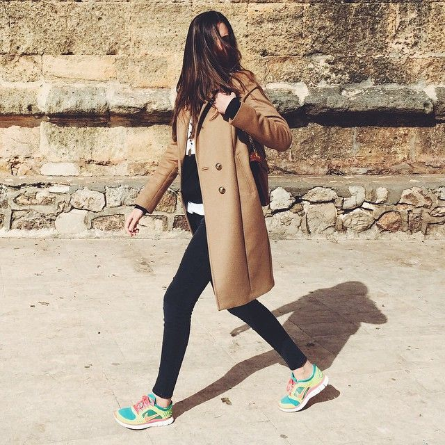 Instagram Fashion, March 2015: Carla Hinojosa is wearing a camel coat from Etrom black skinny jeans and multi coloured sneakers from Nike