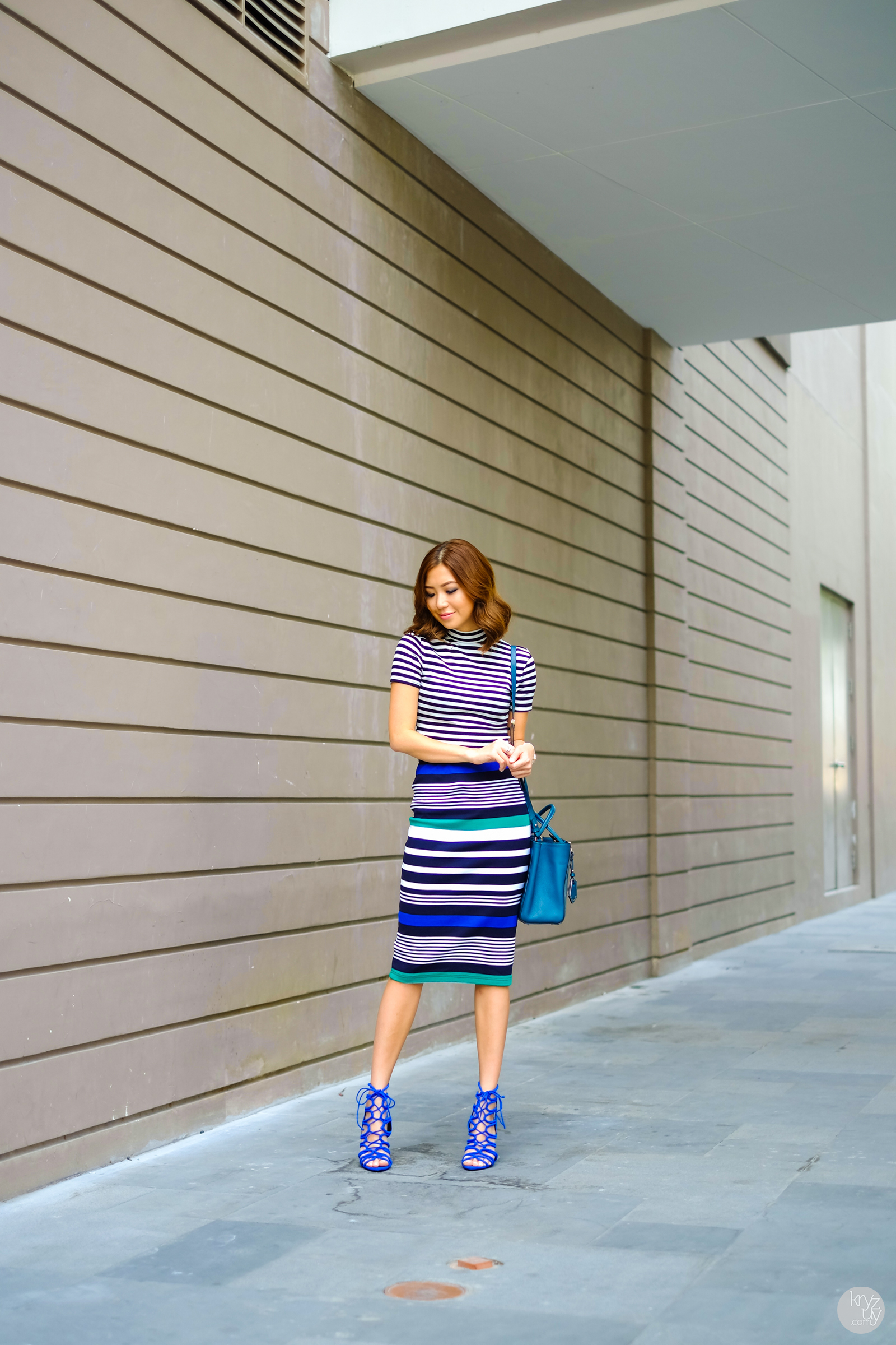 Stripped Outfit Ideas: Kryz Uy outfit consists of a Romwe turtleneck top with a body con mid length Gu Japan skirt